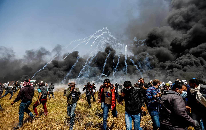 إصابة 18 فلسطينيا خلال مواجهات مع الجيش الإسرائيلي بالضفة
